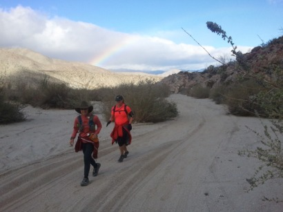 Mary Lou and Alisa as we head up Pinyon Wash, see the rainbow.